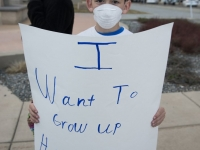 A boy demonstrates against oil and gas development in Broomfield County prior to the county's public meeting.